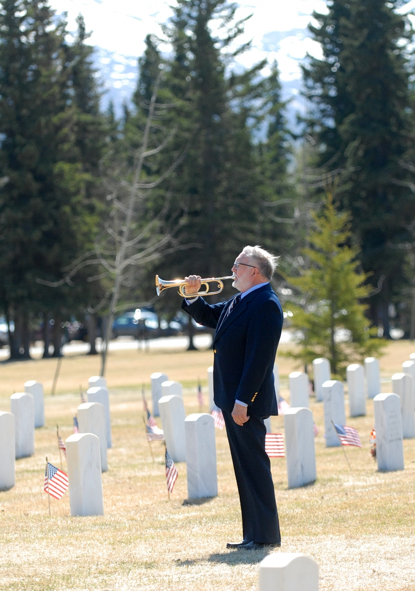 Bugler Tom Meacham, of Bugles Across America, plays Echo Taps during a Memorial Day ceremony held Monday, May 27 at the Fort Richardson National Cemetery.